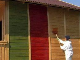 Строительство домов из бруса: краска для стен