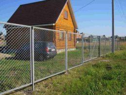 Строительство домов из бруса: забор для участка